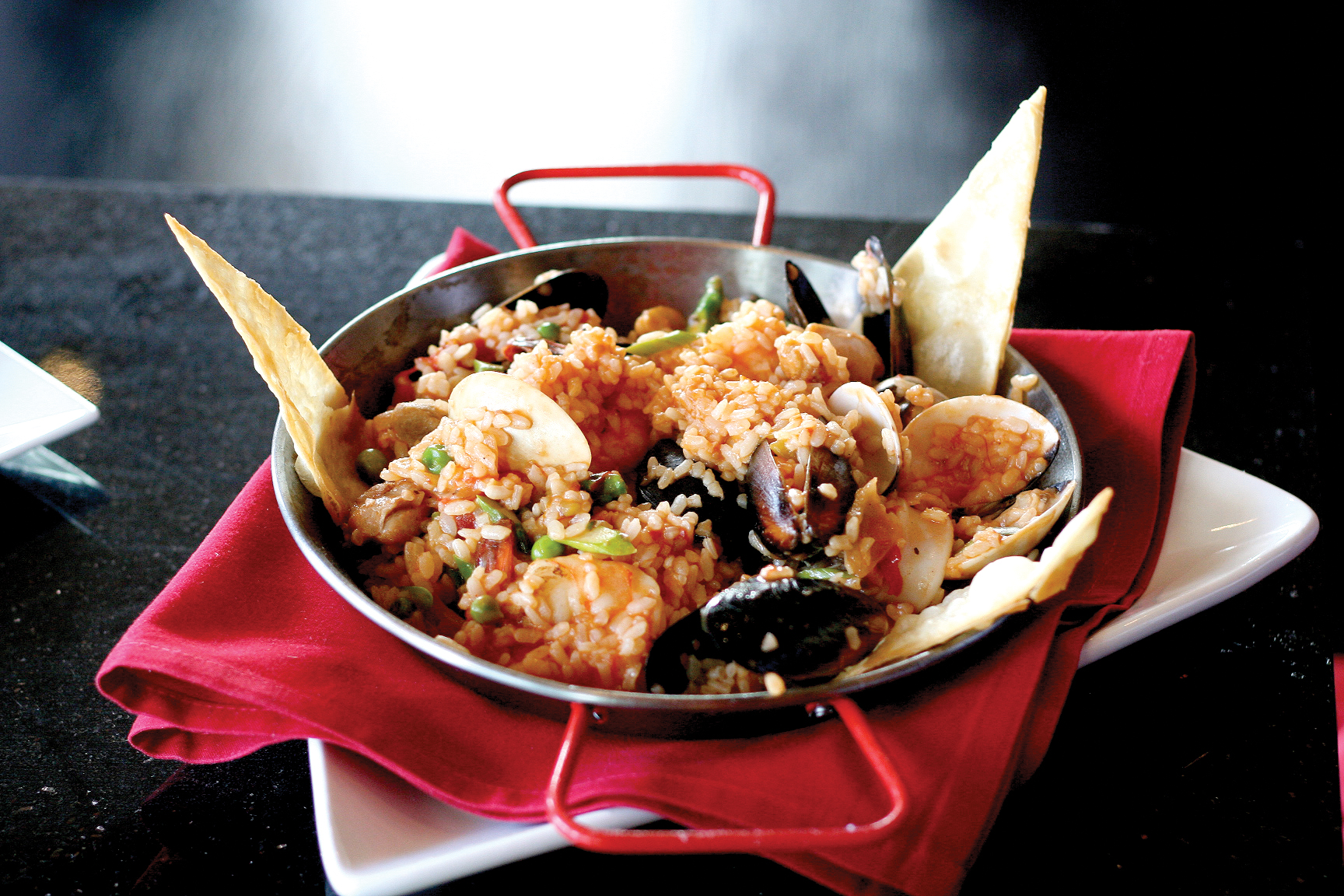Paella: Seafood medley with clams, mussels, calamari, scallops, shrimp ...